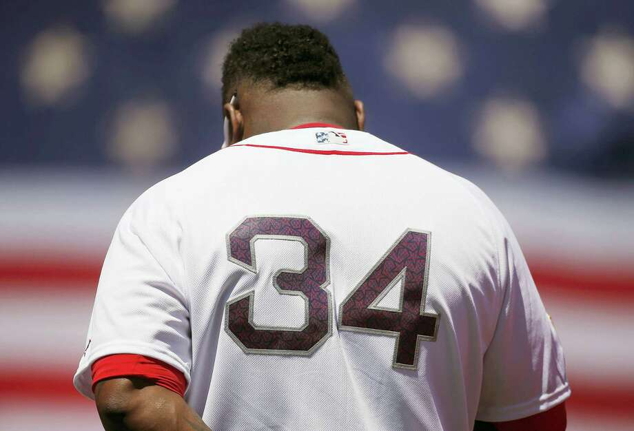 Boston's David Ortiz, bowing his head during the national anthem before a game against the Texas Rangers in Boston Monday, was selected to his 10th All-Star game Tuesday. Photo: The Associated Press   / AP