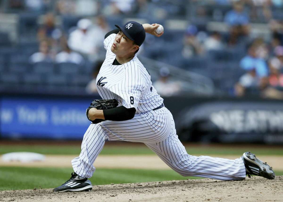 Masahiro Tanaka delivers a pitch during the sixth inning against the Indians ion Sunday.