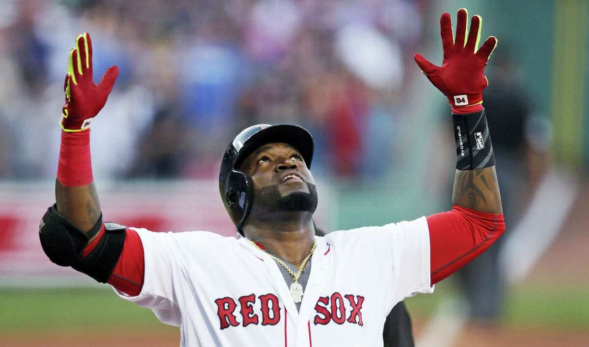 Boston designated hitter David Ortiz celebrates after his two-run home run off Texas Rangers starting pitcher Martin Perez during the first inning at Fenway Park Wednesday. Boston beat Texas 11-6.