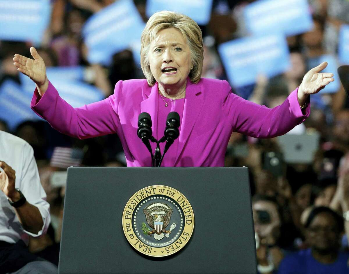 THE ASSOCIATED PRESS Democratic presidential candidate Hillary Clinton speaks at a campaign rally in Charlotte, N.C., Tuesday with President Barack Obama.