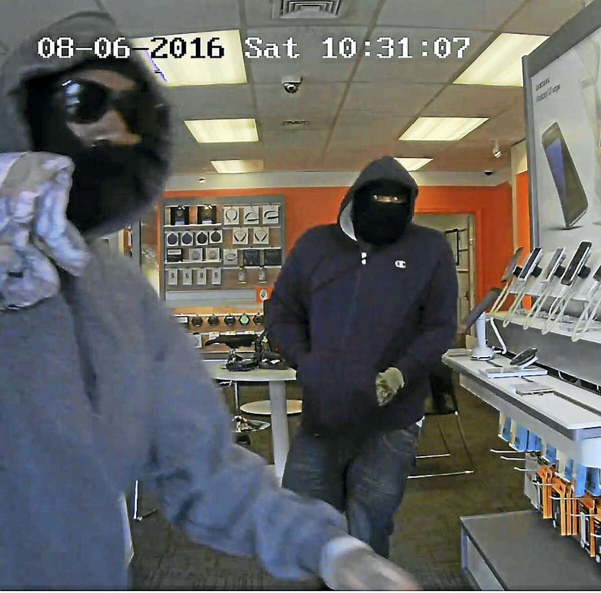 East Haven police are searching for two suspects who allegedly stole iPhones and cash from an AT&T store on Foxon Boulevard on Saturday, August 6, 2016.