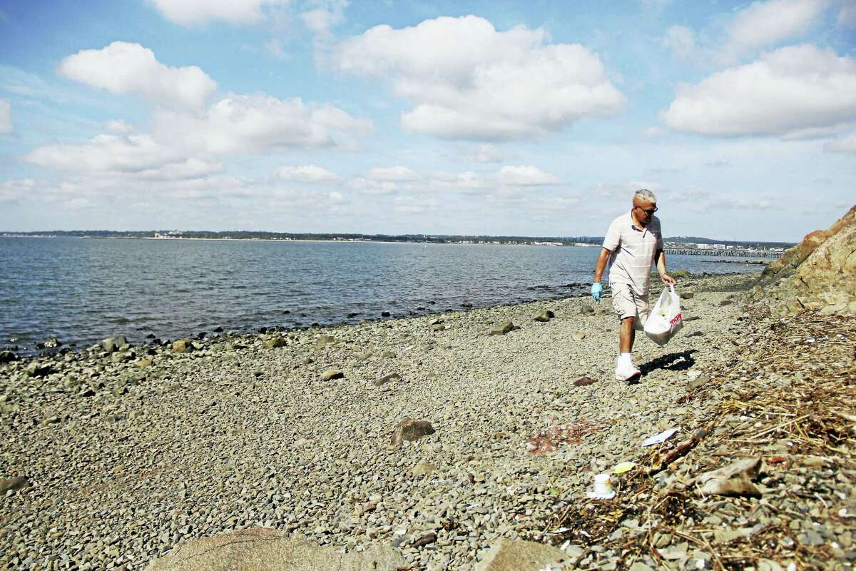 Paul Maccio walks most days along the East Shore to Fort Nathan Hale and he will stop to pick up trash along the shoreline.