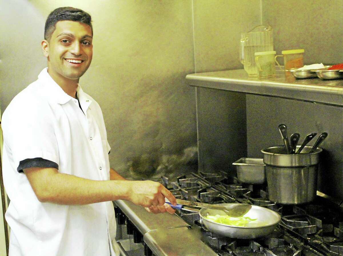 House of Naan owner Harry Singh preparing the restaurant's signature dishes.