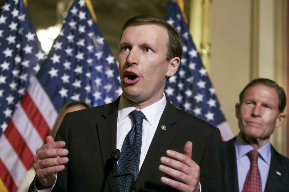 Sen. Chris Murphy, D-Conn., left, accompanied by Sen. Richard Blumenthal, D-Conn., right. Photo: THE ASSOCIATED PRESS FILE PHOTO / AP