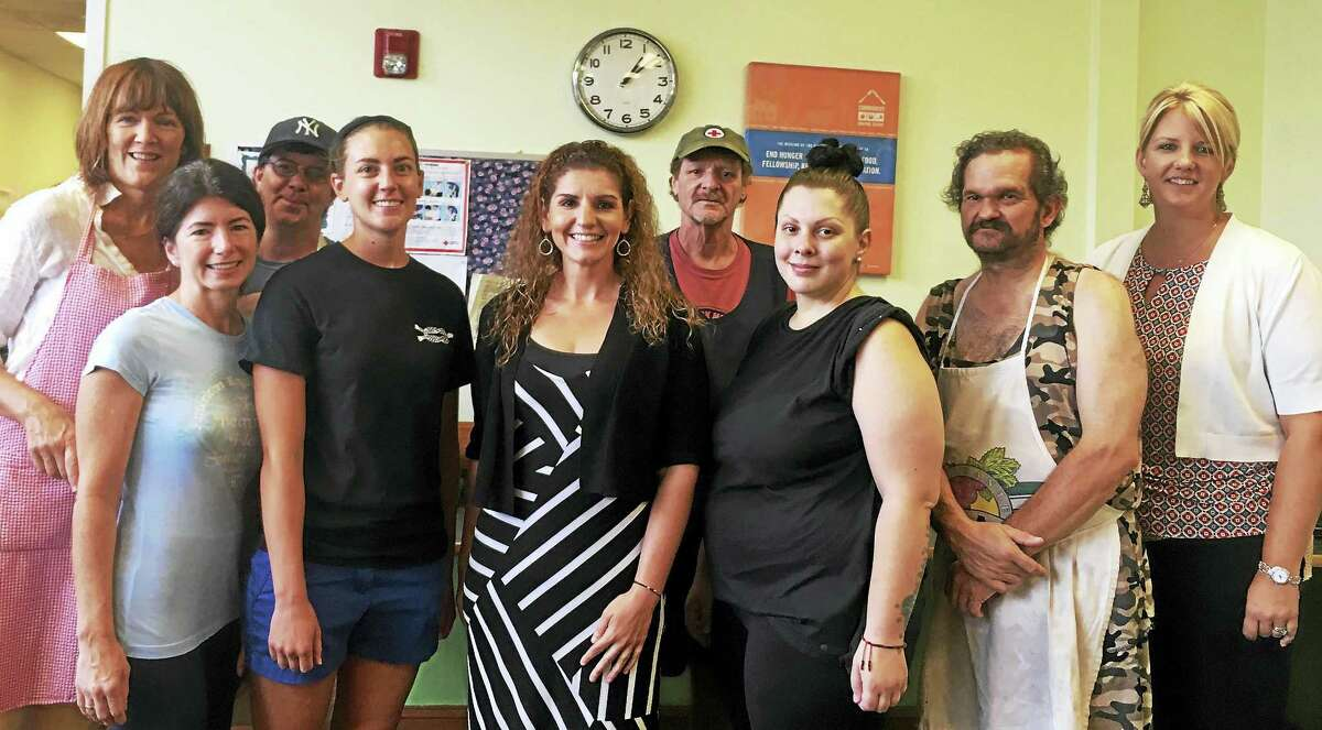 Since taking over as the Community Dining Room's executive director in January, Judy Barron, center, said she is hoping to expand the organization's outreach by increasing the number of its volunteers in order to serve more meals for the needy.