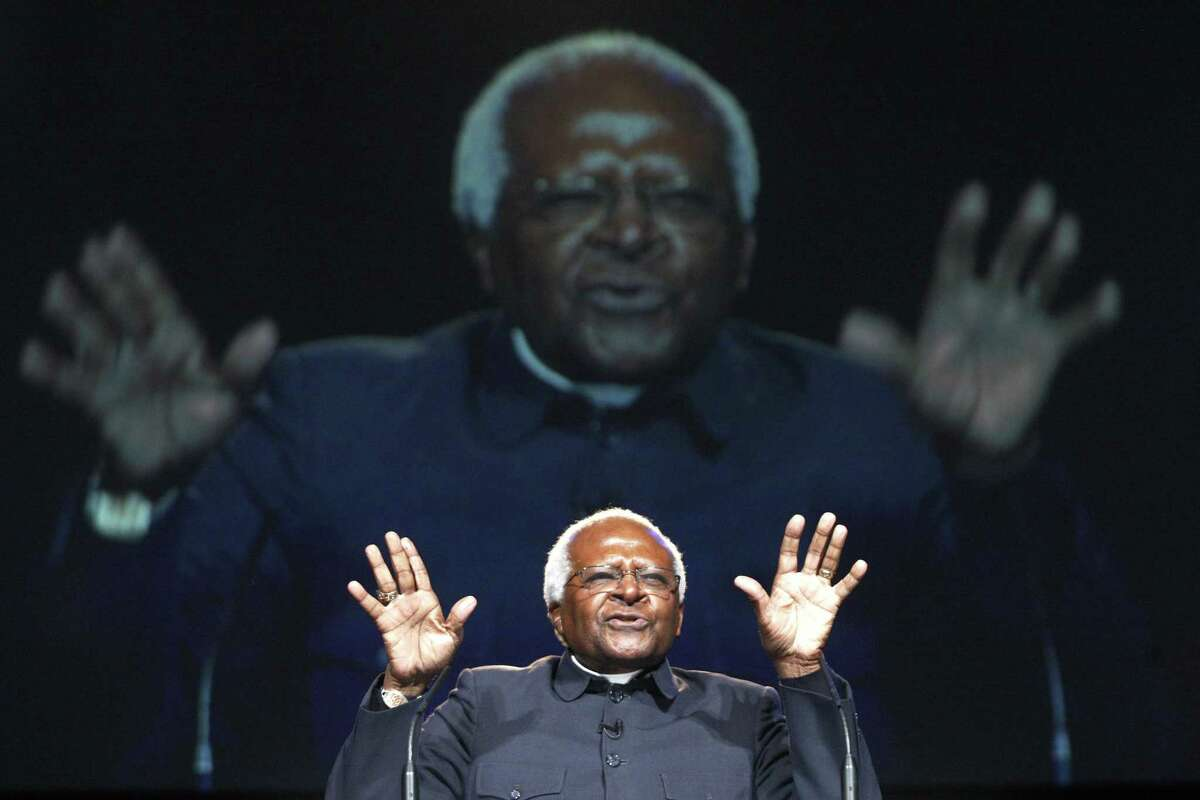 South African Archbishop Desmond Tutu addresses youths at the One Young World,World Summit at Old Billingsgate in London in 2010.