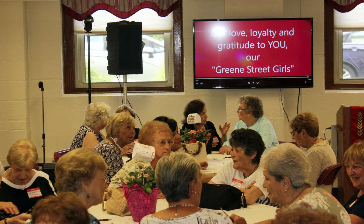 The 'Greene Street Girls' enjoy a pizza luncheon marking Sacred Heart Academy's Founders' Day celebration Wednesday.