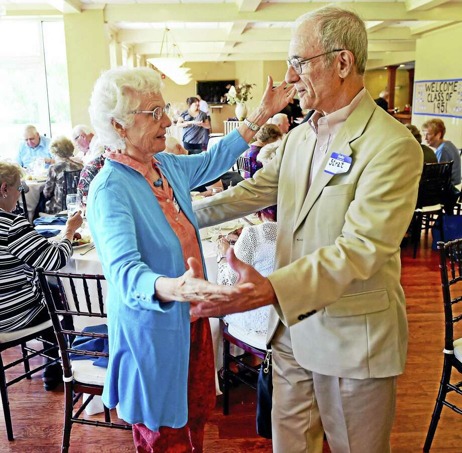 Peter Hvizdak - New Haven Register  Carmela Grova Loda of Ithaca , NY. left, with high school friend Stratos Guiliotis of Los Gatos, California, both from the Ansonia High School class of 1951 feign dancing during a class reunion Sunday afternoon at the Traditional Golf Club at Oak Lane in Woodbridge. The two friends became dancing partners at an earlier reunion and were nicknamed Fred and Ginger after legendary dancers Fred Astaire and Ginger Rogers. Photo: ©2016 Peter Hvizdak / ©2016 Peter Hvizdak