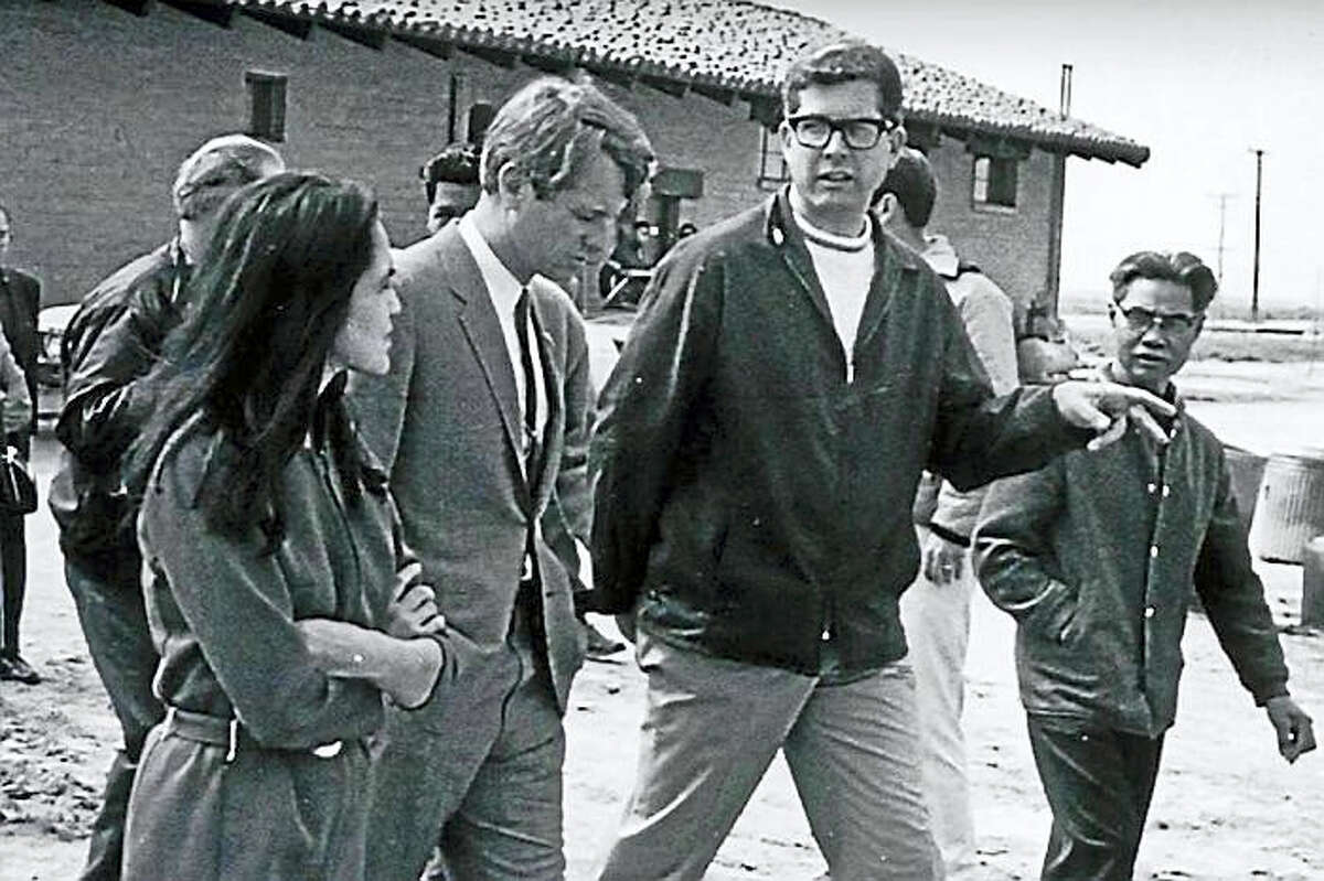 Robert F. Kennedy, center, flanked by union organizers Dolores Huerta, left, and Paul Schrade, right. Huerta co-founded what would become the United Farm Workers. Schrade, also a union organizer, was one of five others wounded when RFK was assassinated in 1968.