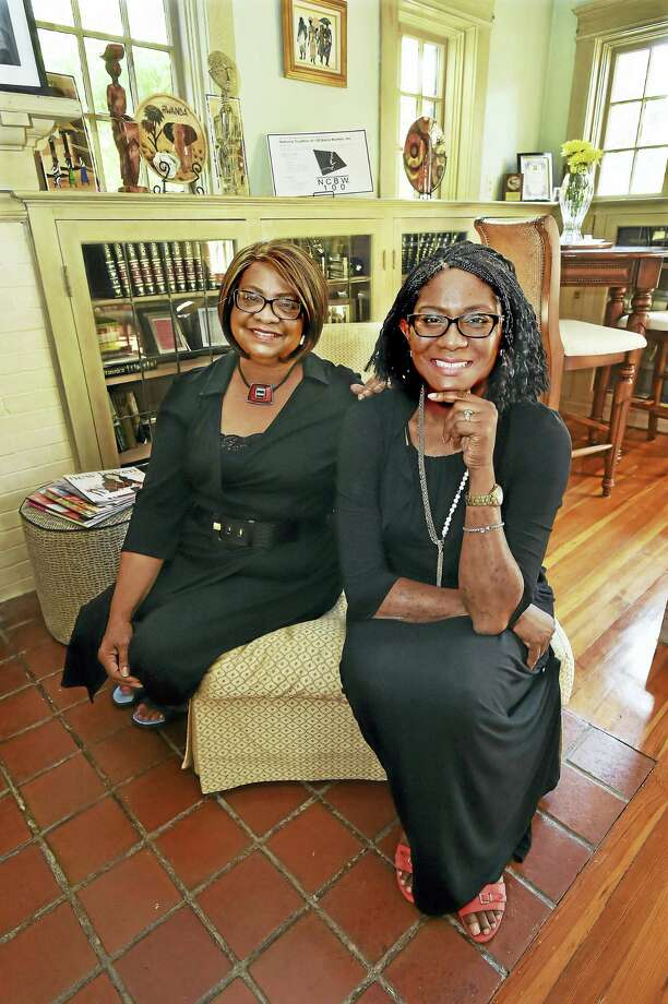 National Coalition of 100 Black Women Inc. New Haven Metropolitan chapter co-founders Melba Lee, chairwoman of the board of directors, left, and Valencia Goodridge, president-elect, at Goodridge's home. Photo: Catherine Avalone — New Haven Register   / New Haven RegisterThe Middletown Press