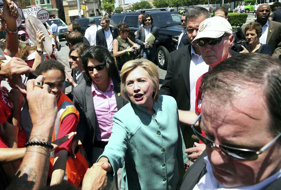 Democratic presidential candidate Hillary Clinton greets striking workers outside the Trump Taj Mahal Casino and Hotel Wednesday in Atlantic City, New Jersey. Photo: ASSOCIATED PRESS   / Copyright 2016 The Associated Press. All rights reserved. This material may not be published, broadcast, rewritten or redistribu