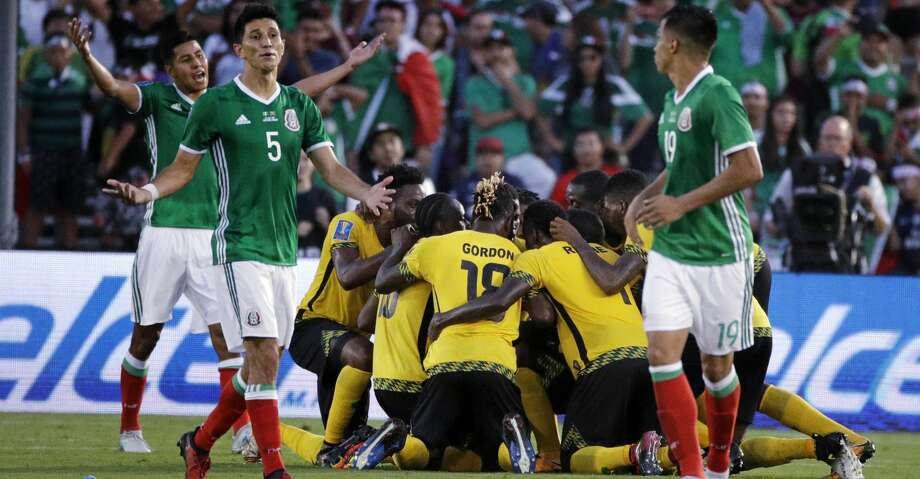 Mexico's Jesus Molina (5) reacts as players celebrate a goal by Jamaica's Kemar Lawrence during the second half of a CONCACAF Gold Cup semifinal soccer match in Pasadena, Calif., Sunday, July 23, 2017. (AP Photo/Jae Hong) Photo: Jae Hong/Associated Press