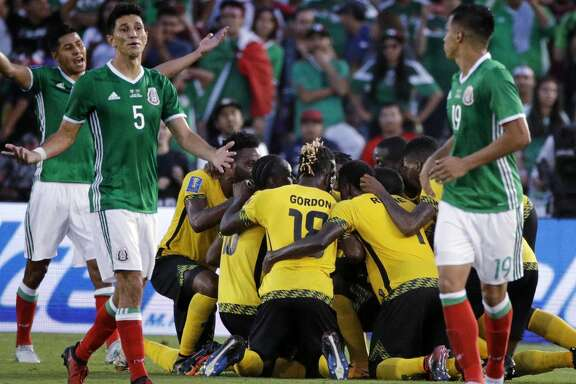 Mexico's Jesus Molina (5) reacts as players celebrate a goal by Jamaica's Kemar Lawrence during the second half of a CONCACAF Gold Cup semifinal soccer match in Pasadena, Calif., Sunday, July 23, 2017. (AP Photo/Jae Hong)