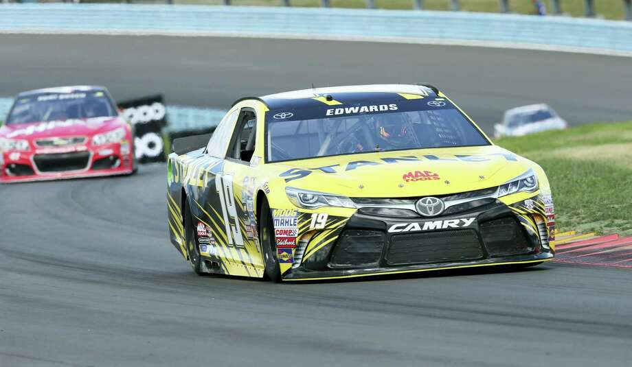 Carl Edwards (19) races ahead of Kurt Busch (41) during qualifying on Saturday at Watkins Glen International. Edwards won the pole. Busch qualified 17th. Photo: Mel Evans — The Associated Press   / Copyright 2016 The Associated Press. All rights reserved. This material may not be published, broadcast, rewritten or redistribu
