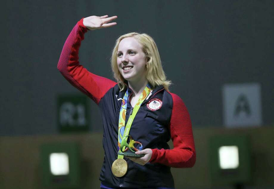 Virginia Thrasher of the United States waves after she received the gold medal for the Women's 10m Air Rifle competition in Rio on Saturday. Photo: Eugene Hoshiko — The Associated Press   / Copyright 2016 The Associated Press. All rights reserved. This material may not be published, broadcast, rewritten or redistribu