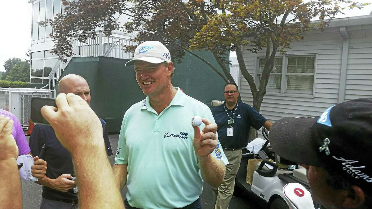 Ernie Els shows off the ball he made an ace with on the 16th hole at TPC River Highlands on Saturday.