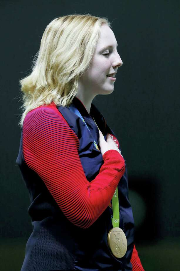 Gold medal winner, Virginia Thrasher of the United States, sings along with the U.S. national anthem after receiving the gold medal during the victory ceremony for the Women's 10m Air Rifle event at Olympic Shooting Center at the 2016 Summer Olympics in Rio de Janeiro on Saturday. Photo: Hassan Ammar — AP Photo    / Copyright 2016 The Associated Press. All rights reserved. This material may not be published, broadcast, rewritten or redistribu