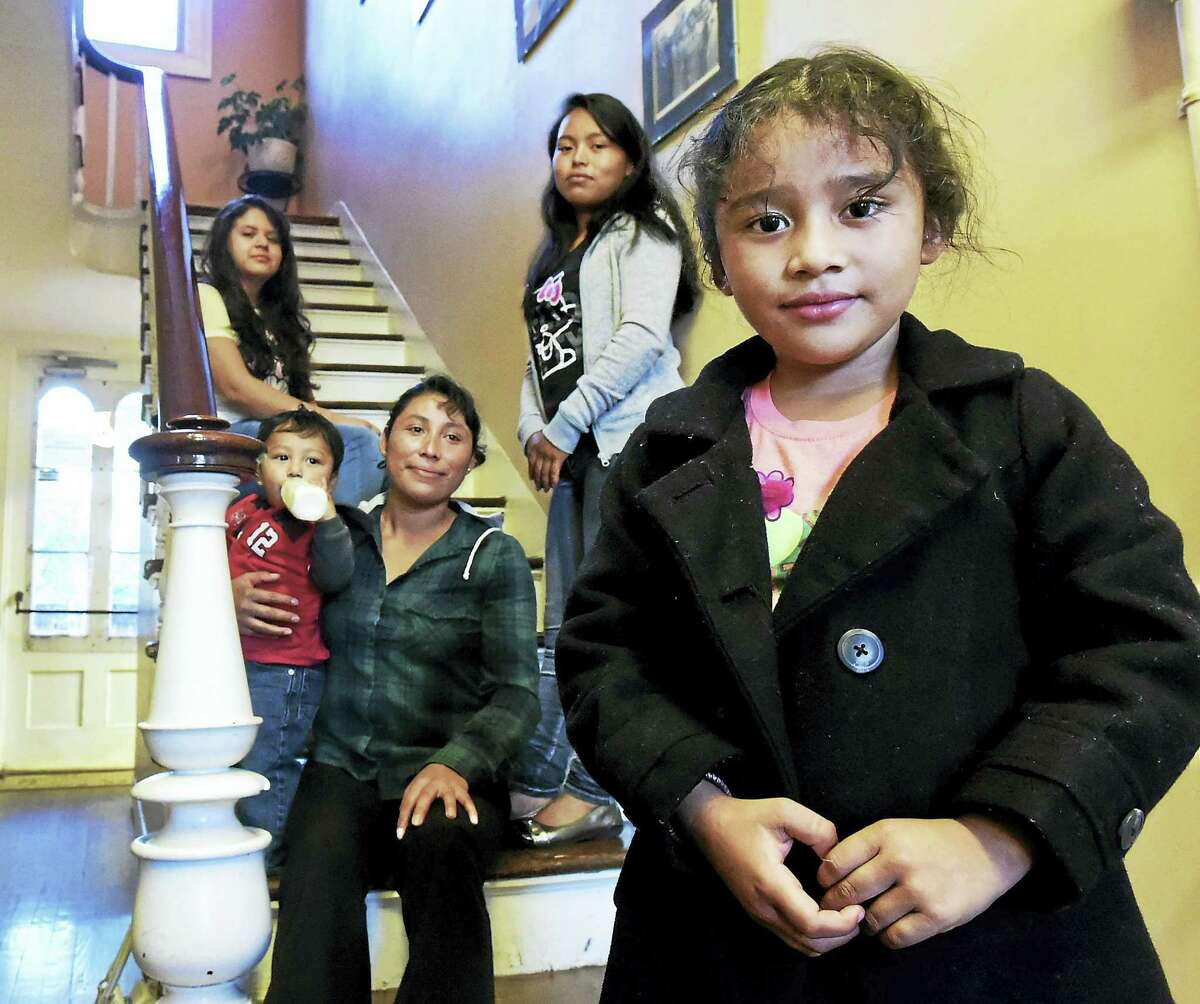 Hazel Mencos Jimenez, 15, top left, Antonia Hernandez Berduo, 20, third from left, with Alva Morales Perez with her children Darwin Arreaga 1, and Liliana Berenice Morales, 4, far right, are immigrants from Guatemala and have been living in the New Haven area approximately 2 years ago after they made the dangerous journey through their country into Mexico and eventually across the Rio Grande into Texas as part of the estimated 90,000 who have flooded into the United States escaping poverty and violence in Central America.