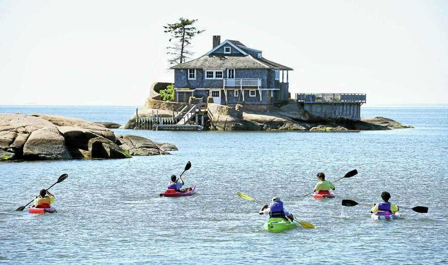 Campers from Camp Totokett hug the shoreline heading out from Killian's Point in Branford. Photo: Arnold Gold — New Haven Register
