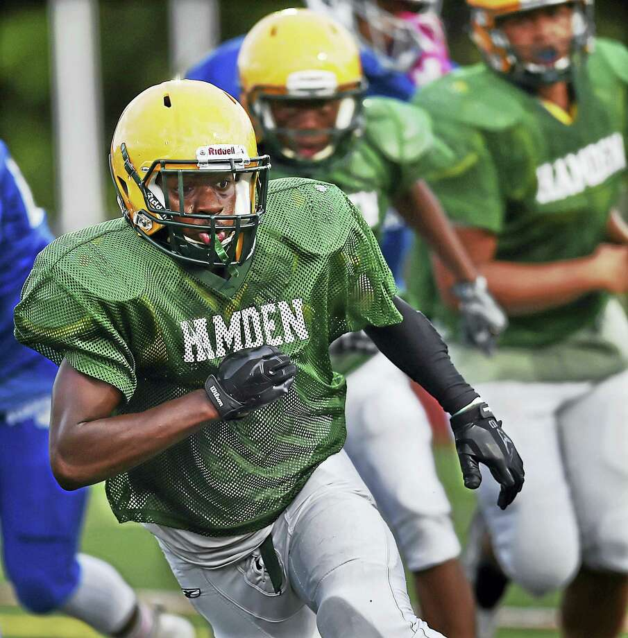 Hamden Head Coach Tommy Dyer on the sidelines against Bunnell in a pre-season scrimmage, Friday, September 2, 2016, at the Joseph Bruno Field at Hamden High School. The Bulldogs won, 27-6. (Catherine Avalone/New Haven Register) Photo: Journal Register Co. / New Haven RegisterThe Middletown Press