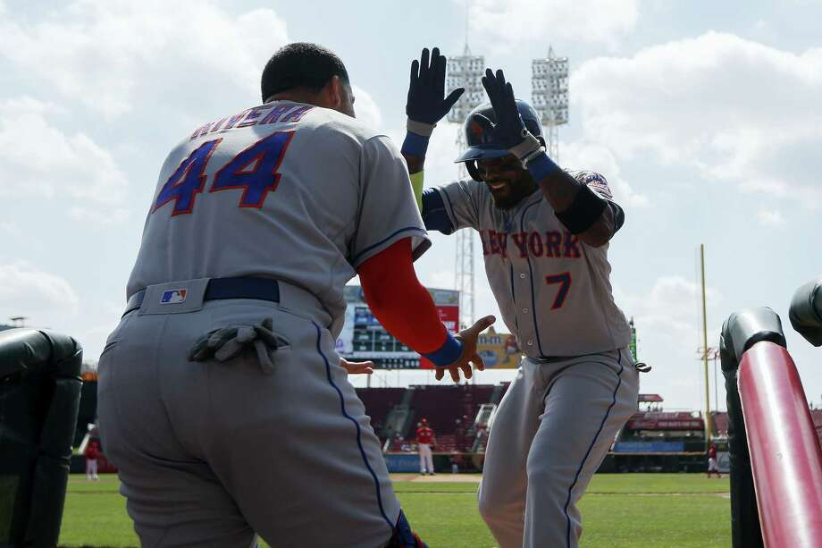 New York'S Jose Reyes celebrates in the dugout after hitting a solo home run off Cincinnati Reds starting pitcher Anthony DeSclafani in the first inning Wednesday in Cincinnati. The Mets won 6-3. Photo: JOHN MINCHILLO — THE ASSOCIATED PRESS   / AP