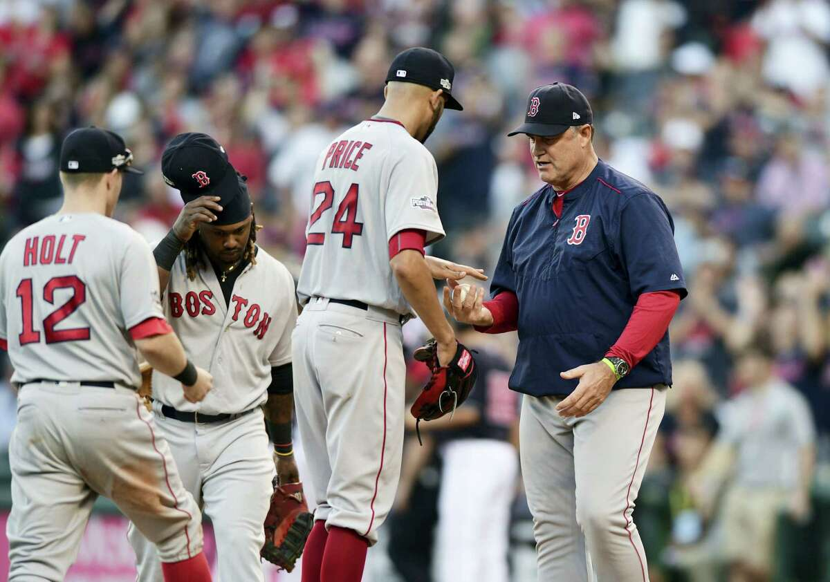 Red Sox manager John Farrell, right, takes the ball from pitcher David Price in the fourth inning on Friday.