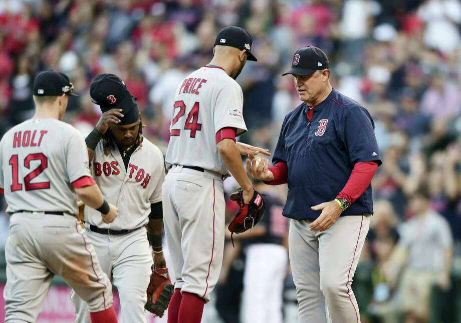 Red Sox manager John Farrell, right, takes the ball from pitcher David Price in the fourth inning on Friday. Photo: David Dermer — The Associated Press   / FR171035 AP