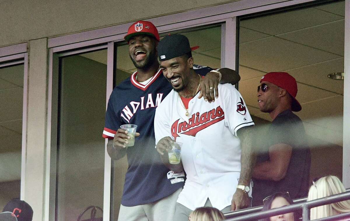 The Cavaliers' LeBron James, left, stands with J.R. Smith during the sixth inning Friday.