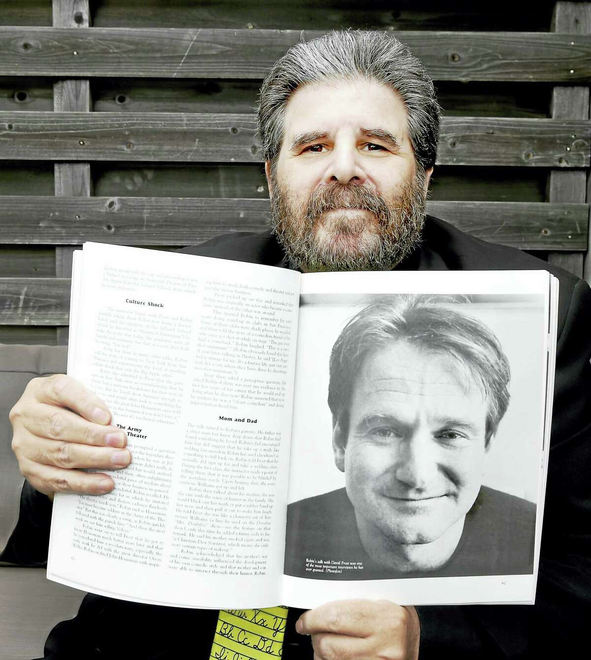 """Author Stephen Spignesi with a photo from his book, """"The Robin Williams Scrapbook."""""""