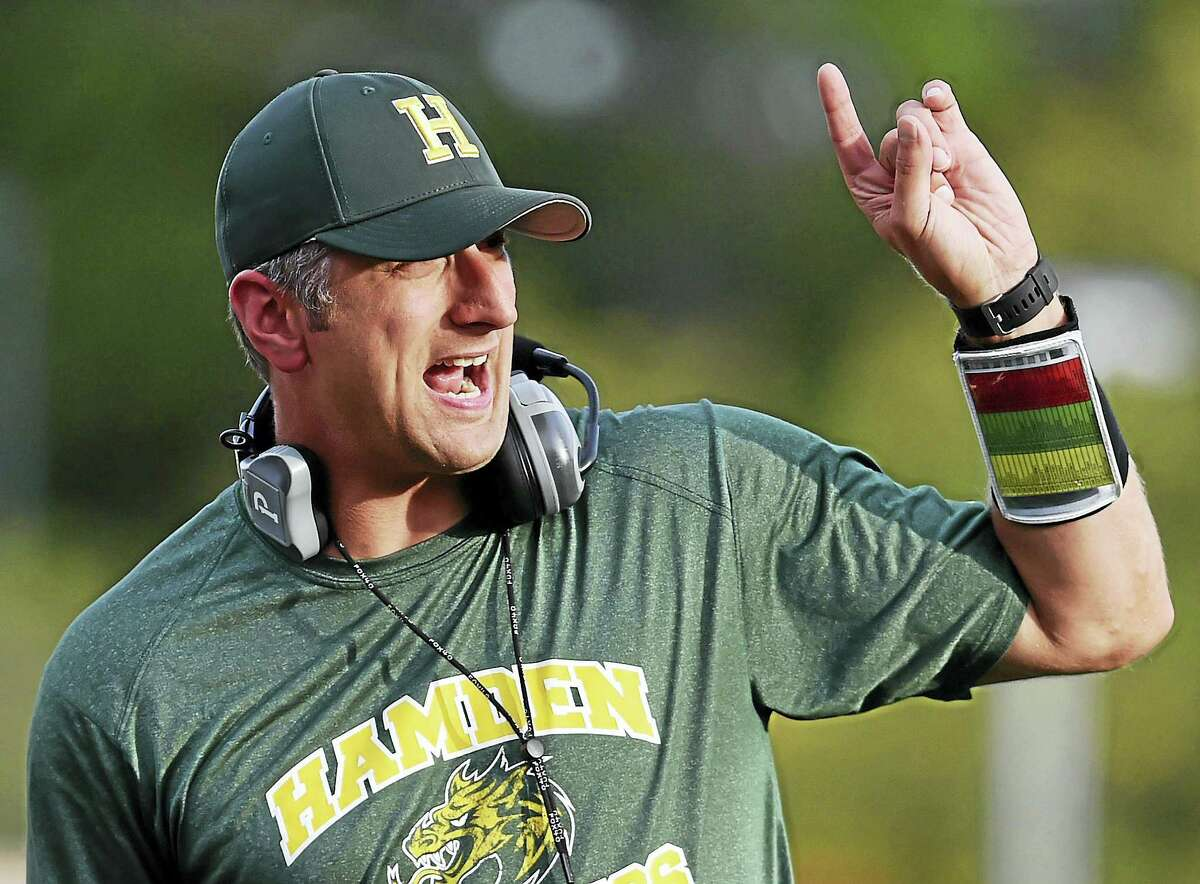 Hamden Head football Coach Tommy Dyer on the sidelines against Bunnell in a preseason scrimmage. Dyer, the school's athletic director, is in his first season as head coach.