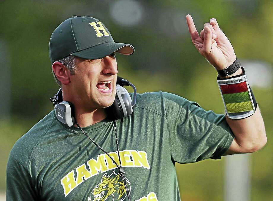 Hamden Head football Coach Tommy Dyer on the sidelines against Bunnell in a preseason scrimmage. Dyer, the school's athletic director, is in his first season as head coach. Photo: Catherine Avalone/New Haven Register   / New Haven RegisterThe Middletown Press