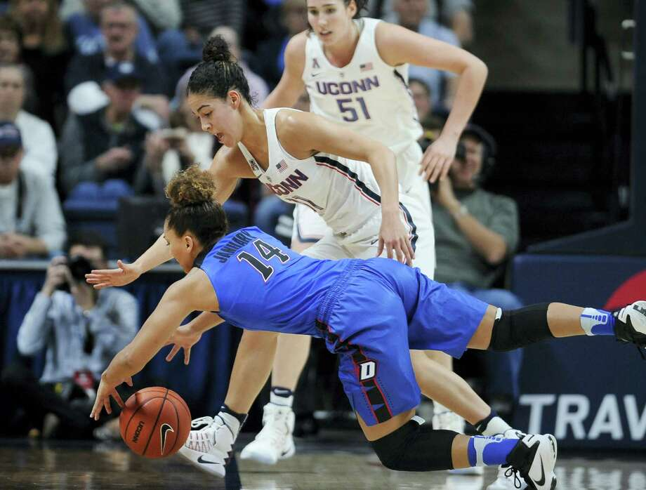UConn's Kia Nurse, top and DePaul's Jessica January chase down a loose ball during the first half of the Huskies' 91-46 win. Nurse scored a career-high 33 points. Photo: Jessica Hill — The Associated Press   / AP2016