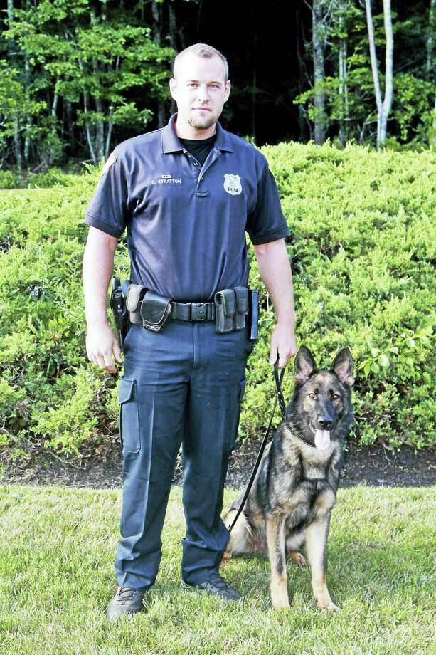 New Haven police Officer Dave Stratton and his police dog Atos, one of the department's patrol division canines. Photo: Contributed Photo