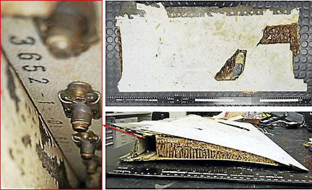 This combination of three photos taken Friday, Oct. 7, 2016, and released by Australian Transport Safety Bureau shows a piece of aircraft debris stored at the ATSB laboratory in Canberra, Australia. Malaysian and Australian officials say this piece of an aircraft wing found on the Indian Ocean island of Mauritius has been identified as belonging to missing Malaysia Airlines Flight 370. The piece of wing flap was found in May and subsequently analyzed by experts at the Australian Transport Safety Bureau, which is heading up the search for the plane in a remote stretch of ocean off Australia's west coast. The red arrow and markings are provided by the source.