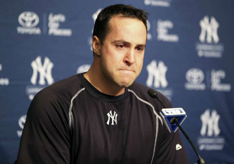Mark Teixeira talks to reporters before Friday's game against the Indians at Yankee Stadium. Teixeira announced that he plans to retire at the end of the season. Photo: Seth Wenig — The Associated Press   / AP