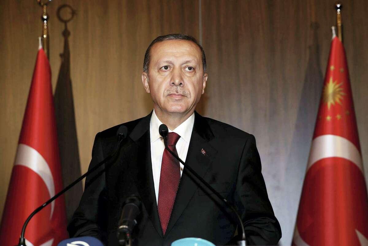 Turkish President Recep Tayyip Erdogan speaks to the media in Antalya, Turkey, in 2015.