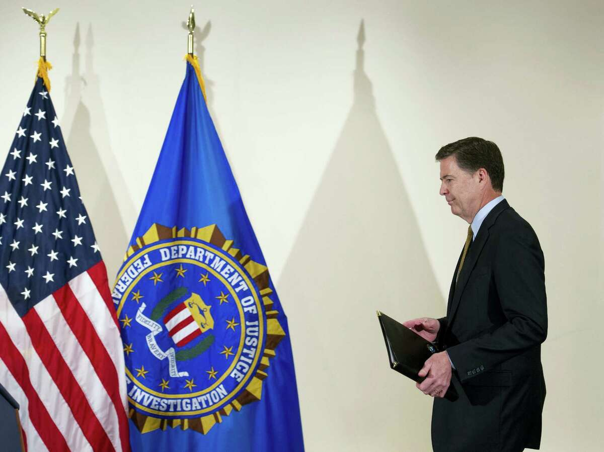 FBI Director James Comey walks to the podium to make a statement at FBI Headquarters in Washington Tuesday.