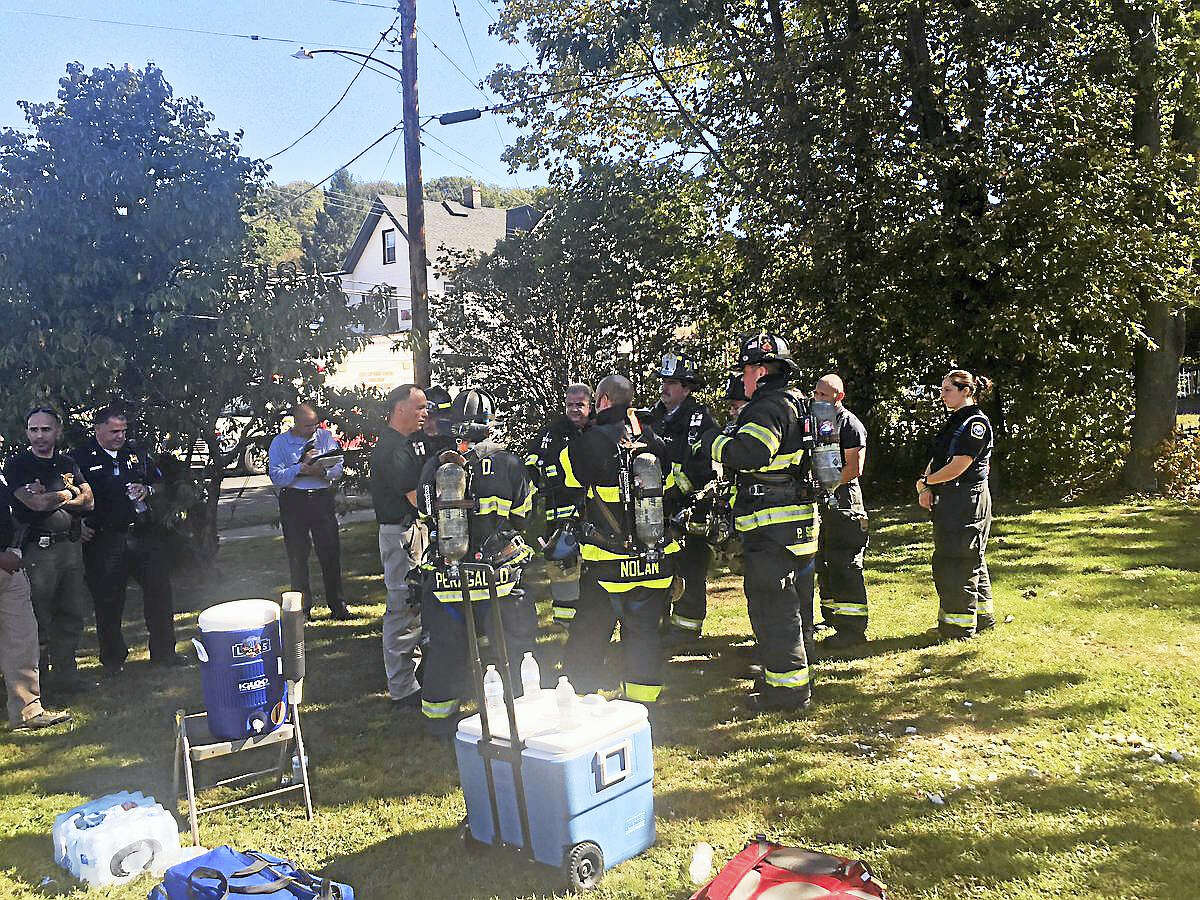 Firefighters were inside an apartment at 70 Fairmont Ave. early Friday afternoon, working to identify an unknown substance there.