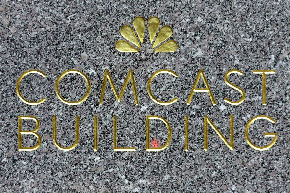 This Thursday, July 23, 2015, photo, shows the Comcast building sign at Rockefeller Center, in New York. Comcast reports financial earnings on Wednesday, Feb. 3, 2016.