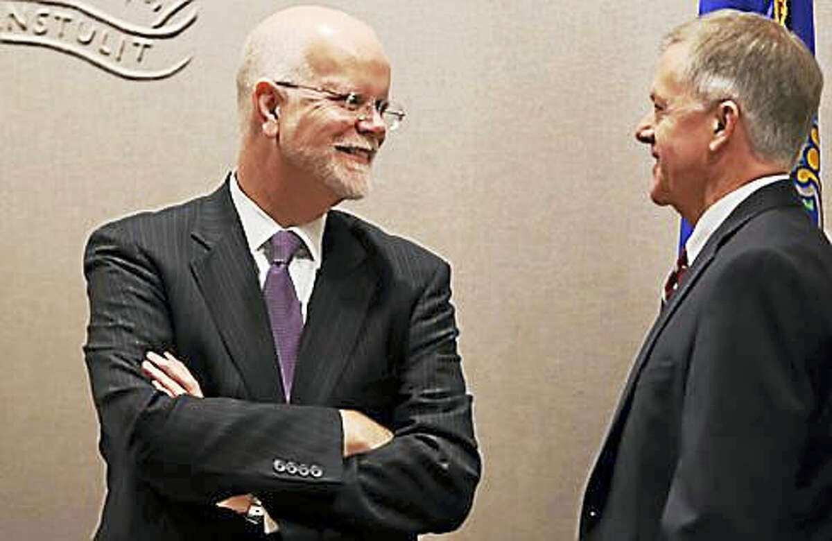 State Comptroller Kevin Lembo chats before the Bond Commission meeting.