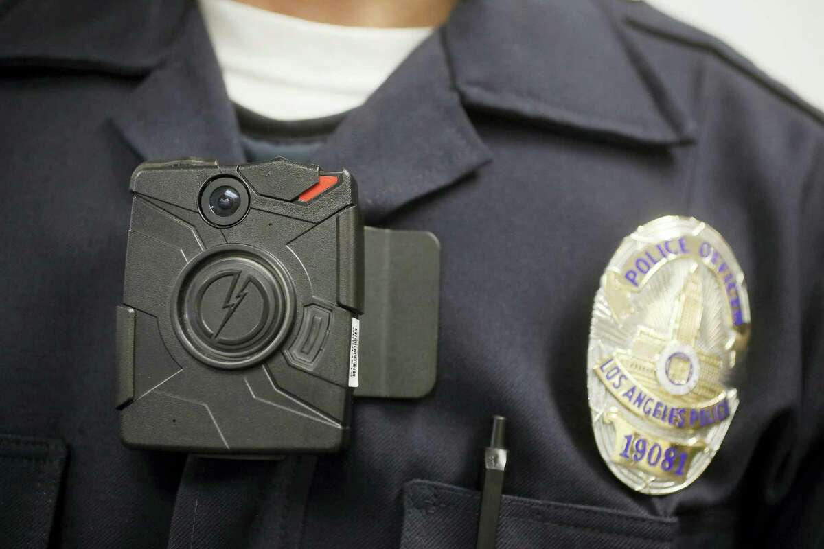 In this Jan. 15, 2014, file photo a Los Angeles Police officer wears an on-body camera during a demonstration in Los Angeles. Few Connecticut police departments are showing interest in a new state program signed into law in 2015 that requires them to begin using body cameras as of July 1, 2016. The state Office of Policy and Management tells The Associated Press that only 10 of the more than 100 law enforcement agencies in the state have contacted the agency about receiving reimbursement under the program for body camera costs.