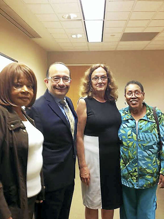 The Commission on Equal Opportunities has hired Angel Fernandez-Chavero, second from left, as its acting executive director. From left is commissioner Edith Rawls, former interim executive director Lila Snyder and commissioner Gwen Newton. Photo: MARY O'LEARY — NEW HAVEN REGISTER