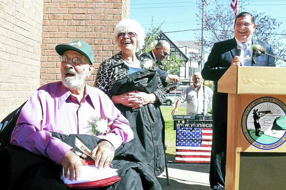 "Giuseppe ""Pepe"" DePalma, left, and his wife, Teresa, are honored as the Italian-American Couple of the Year at the annual Columbus Day Celebration in front of West Haven City Hall Friday. At right is West Haven Mayor Edward O'Brien. Photo: Arnold Gold — New Haven Register"