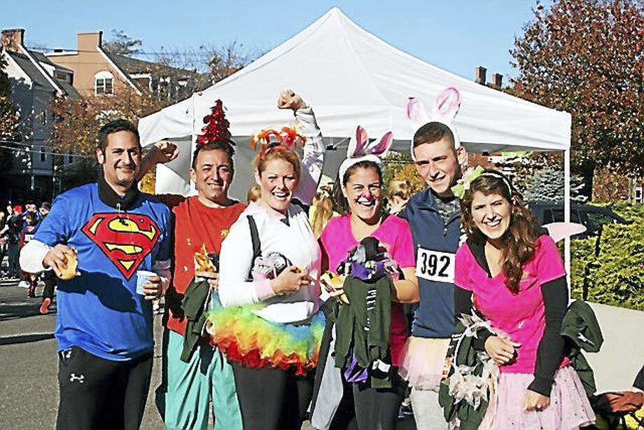 Participants in last year's annual Trick or Trot 5K Run/Walk had a lot of fun dressing up and running to raise money for the homeless and hungry. Photo: CONTRIBUTED PHOTO