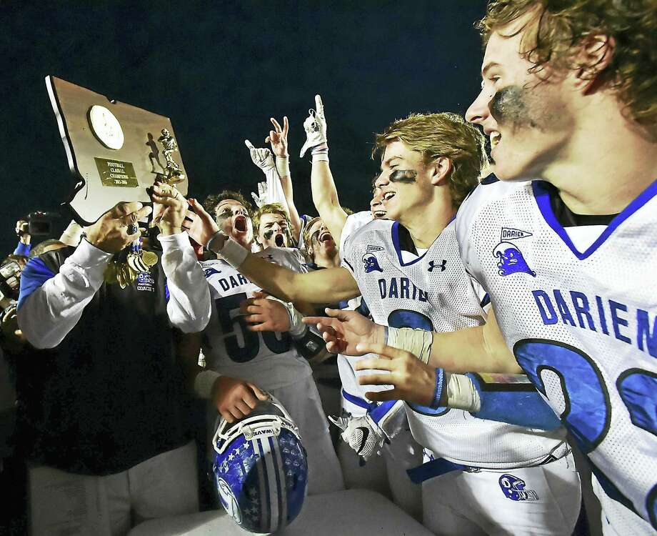 The Darien Blue Wave celebrate after defeating the Shelton Gaels 39-7 for the Class LL state football championship back on December 12, 2015, at New Britain Stadium at Willowbrook Park in New Britain. Darienfinishred No. 1 last season and start the year atop the Register/GameTimeCT Top 10 poll again. Photo: Catherine Avalone — New Haven Register   / Catherine Avalone/New Haven Register