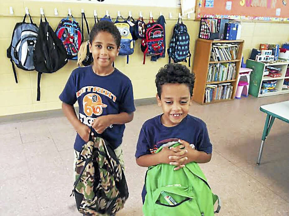 Brothers Christian, 6, and Connor Herron, 5, pose with their backpacks at the Boys and Girls Club of New Haven. The boys helped to organize a backpack donation drive at the club. Photo: Brian Zahn — New Haven Register
