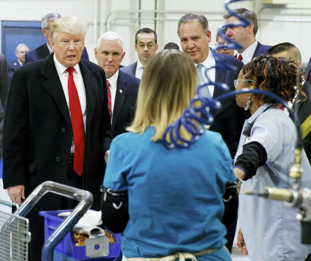 President-elect Donald Trump and Vice President-elect Mike Pence talk to workers during a visit to a Carrier factory, Thursday, Dec. 1, 2016, in Indianapolis, Ind.