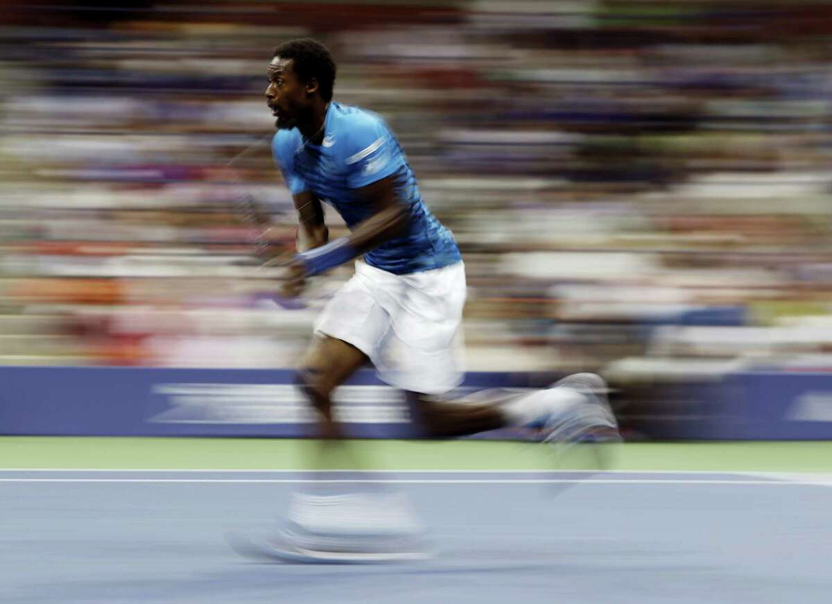 Gael Monfils chases down a shot from Lucas Pouille during the quarterfinals of the U.S. Open tennis tournament Tuesday. Monfils won in straight sets to reach his first U.S. Open semifinal.