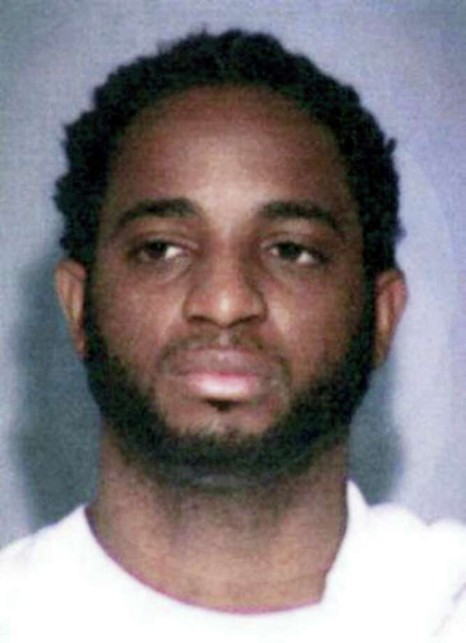"This undated photo provided by the FBI shows fugitive Marlon Jones who is wanted for multiple counts of murder in Los Angeles. The FBI has added Jones, a Jamaican fugitive to its most-wanted list as a suspect in the slaying of four people at a Los Angeles birthday party in October. The FBI announced a reward on Thursday, Dec. 1, 2016 of up to $100,000 for information leading to the arrest of Jones who should be ""considered armed and extremely dangerous."" Photo: FBI Via AP / FBI"