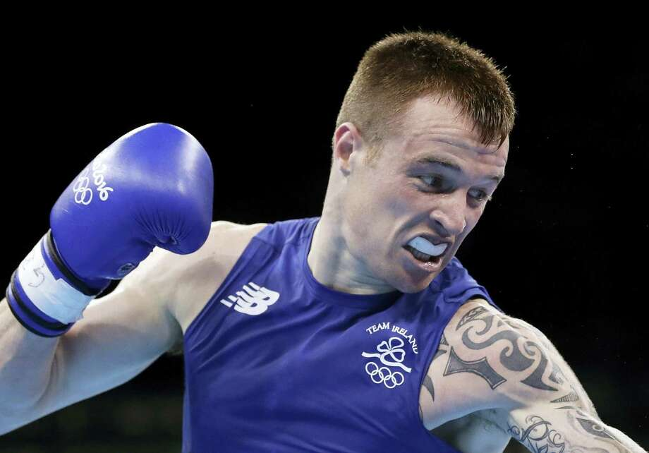 In this file photo dated Aug. 7, 2016, Ireland's Steven Donnelly, fights Algeria's Zohir Kedache during a men's welterweight 69-kg boxing match at the 2016 Summer Olympics in Rio de Janeiro, Brazil. Photo: AP Photo/Frank Franklin II, FILE   / Copyright 2016 The Associated Press. All rights reserved. This material may not be published, broadcast, rewritten or redistribu